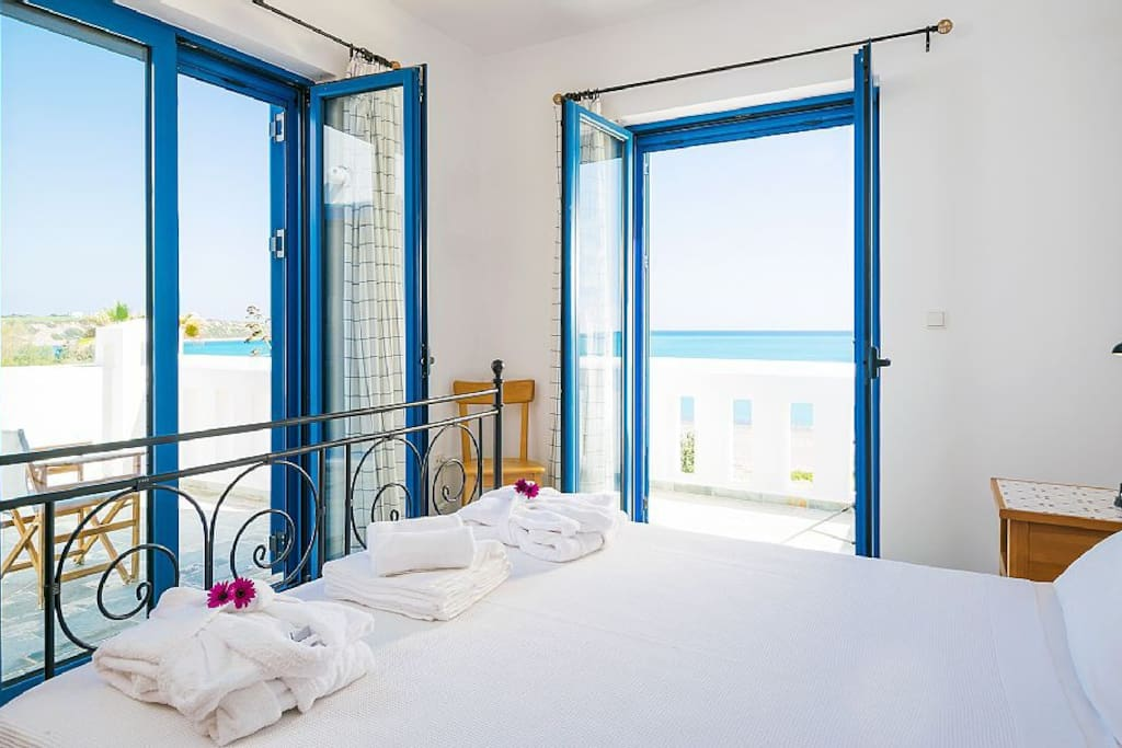 Wake up to the sound of waves and view of the blue sea!