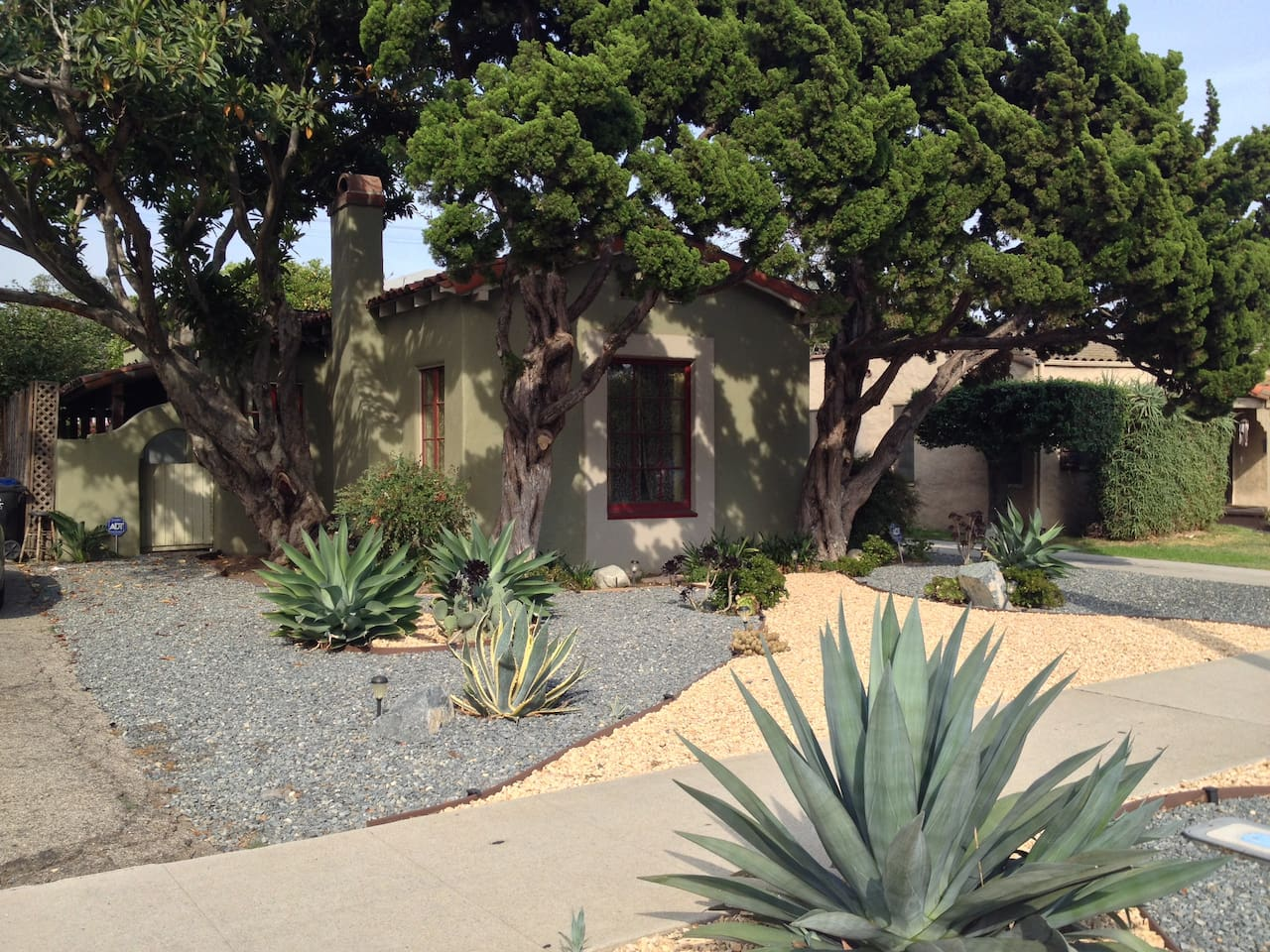 Front view of the house, with drought-tolerant front yard. The driveway to the right fits 2 cars (back to back.)