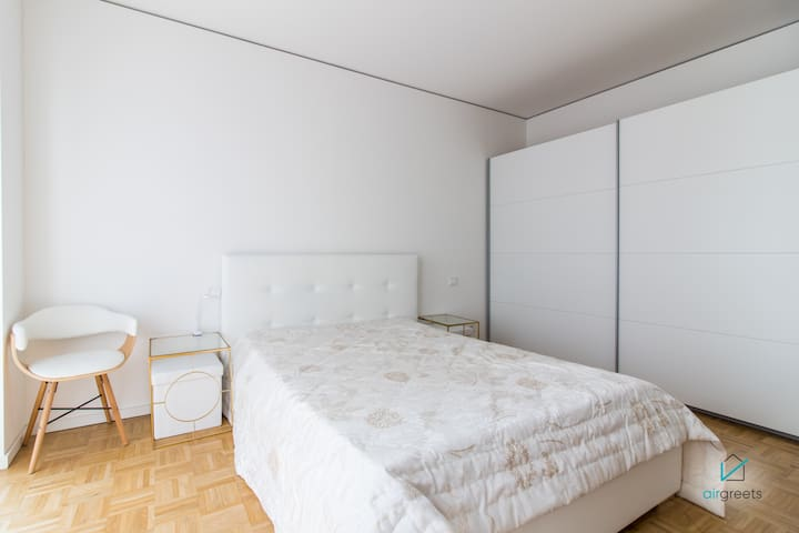 A big bed and plenty of room in the wardrobe.