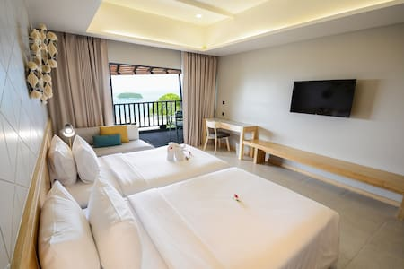 Twin beds with Sea View and private Balcony.