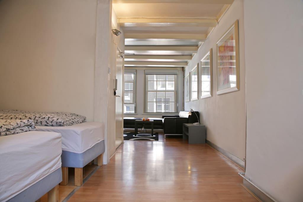 studio with living, kitchenette and bedroom en suite