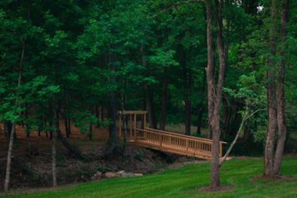 Enjoy walking by the stream and crossing our footbridge to an open field.