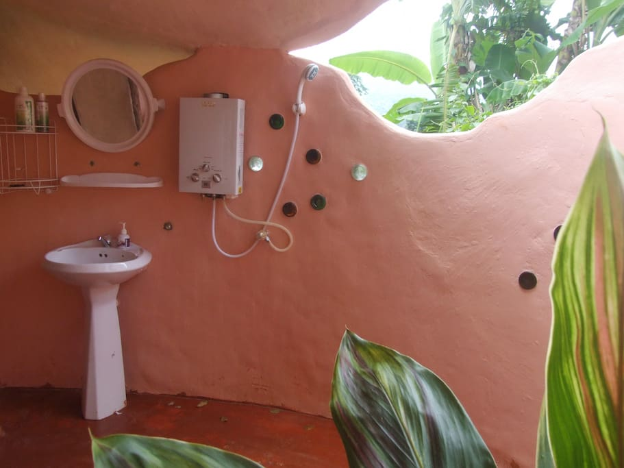 Ensuite bathroom is partially open-air.  You can shower in sunlight and moonlight.