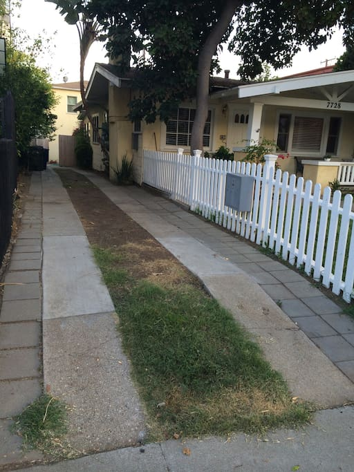 Long driveway reserved for your group, with a door in the white picket fence for easy walkway access from your car.