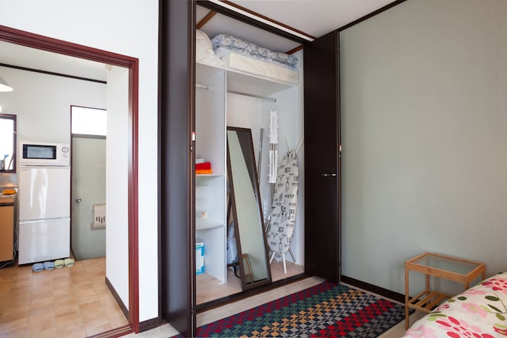 A big mirror and iron board are there.