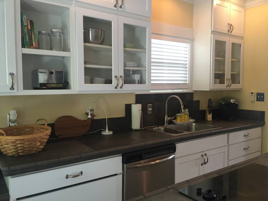 Kitchen with stainless steel dishwasher and appliances. Kuerig coffee maker with K-cups and small regular coffee maker if you prefer your own coffee!