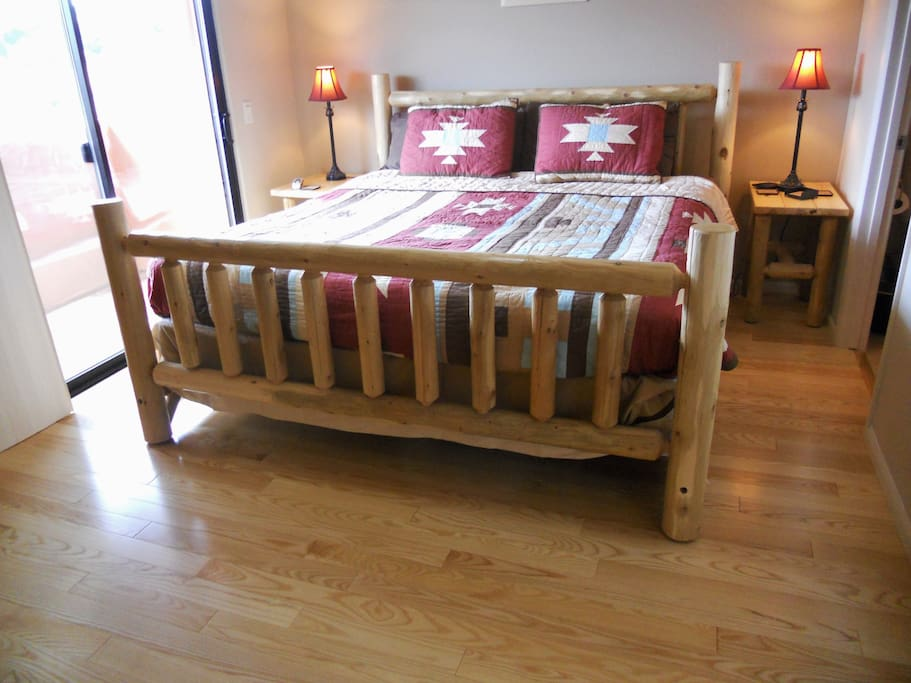 King Log Bed with private balcony and new hardwood floors July 2014