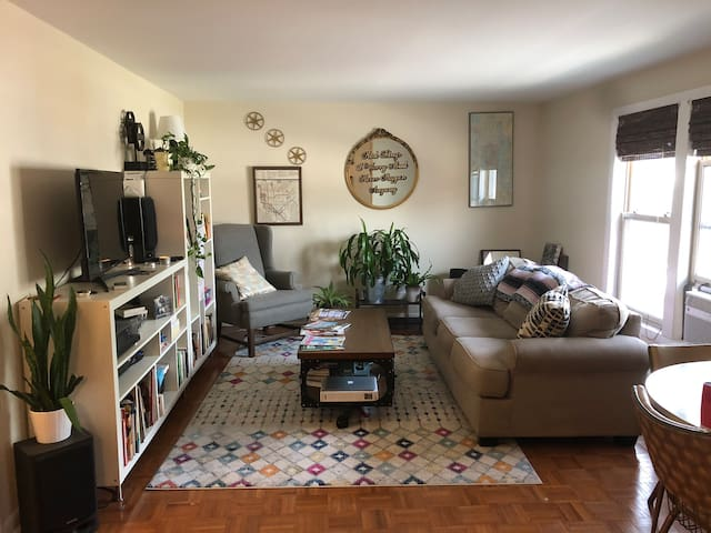 Bright plant filled 1 bd just off Main Street!