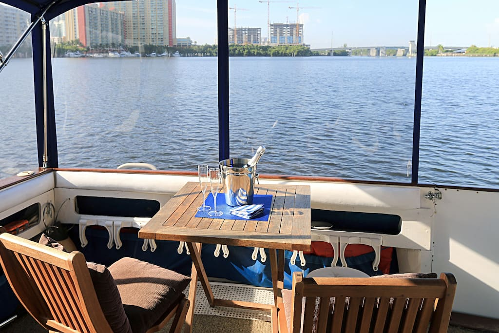 Stern. Amazing view of the intracoastal. Real Teak table and chairs. Crystal Clear Isinglass enclosure panels.