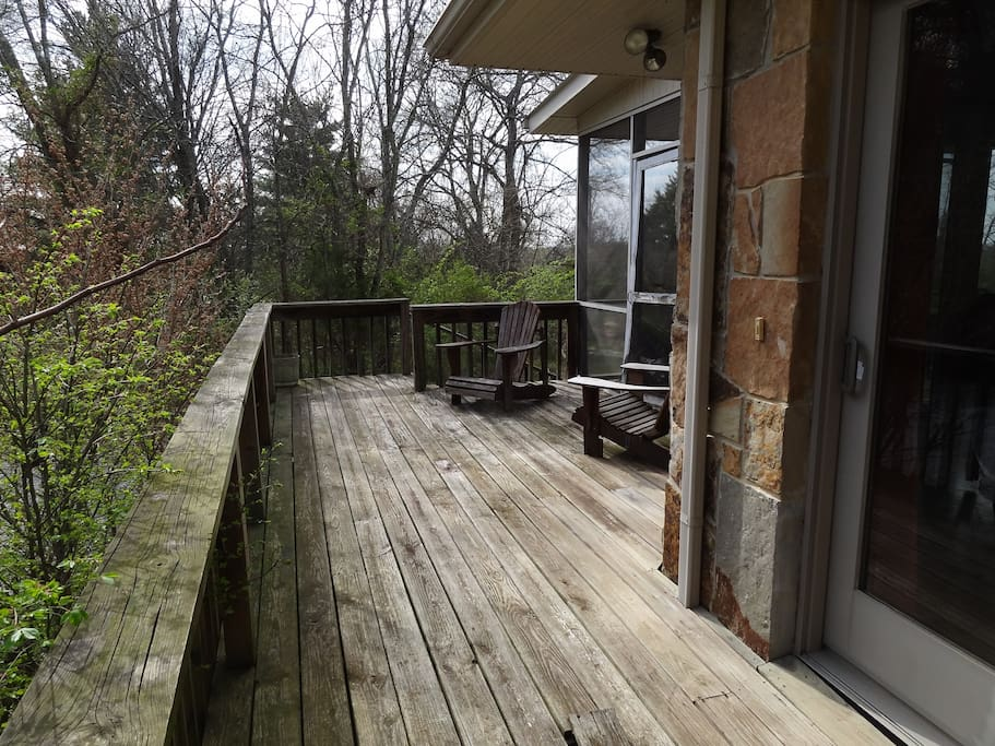 View of deck with wide rail for sitting on.