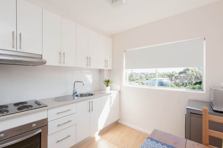 Full kitchen - cook top, microwave oven, a Nespresso machine, toaster and kettle