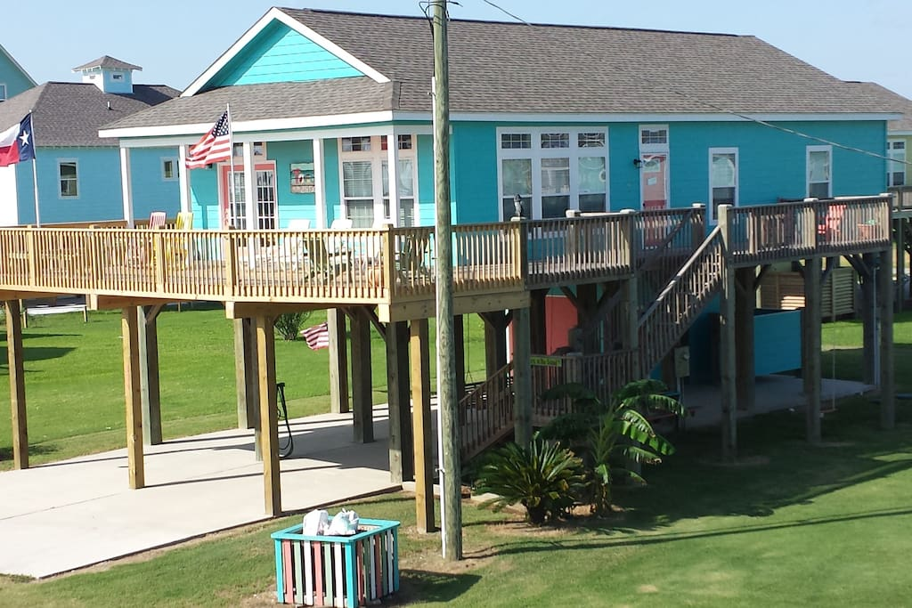 Side of the house that faces the beach - newly expanded deck!