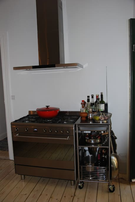 Large Smeg gas stove with electric oven.