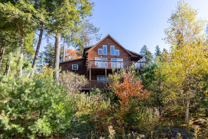 Unique chalet w/ two decks, two fireplaces, & great views - near four lakes