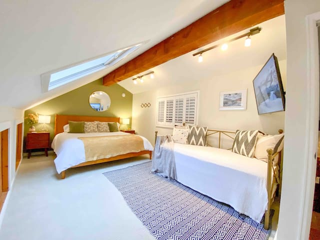 """Upstairs loft with king bed and 2 standard size twin trundles. Twin bed mattress dimensions are full size twin mattresses: 75""""x38"""". The length of the twin beds are same as king or queen. Each bed in loft has soft plush mattress topper."""