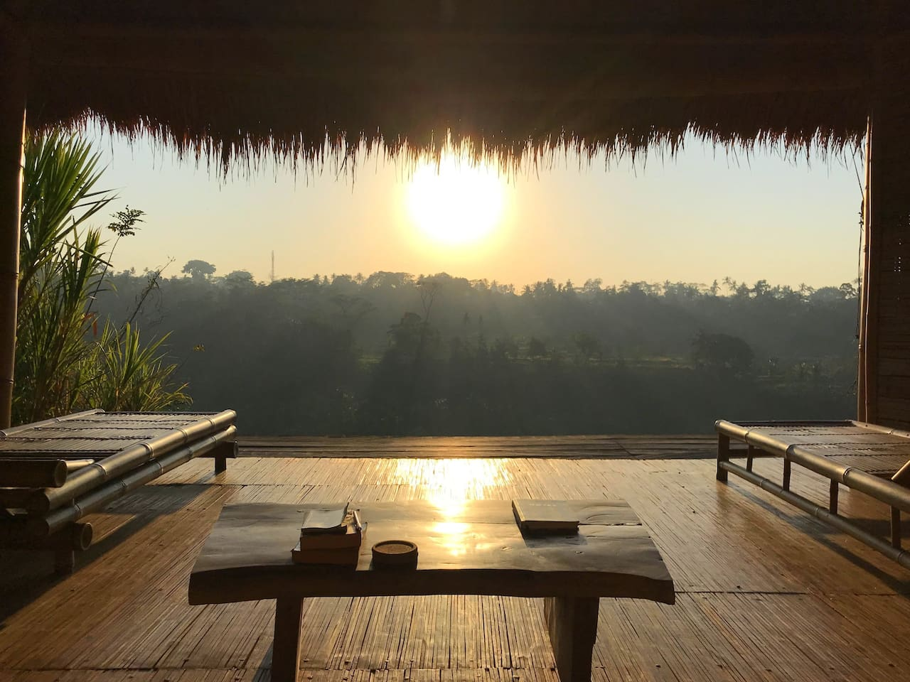 """Panorama Room at sunrise. Our take on Balinese """"Bale Bengong"""", a room for gazing and doing nothing. That is exactly what it is! We invite you to do nothing and gaze at the panoramic view."""