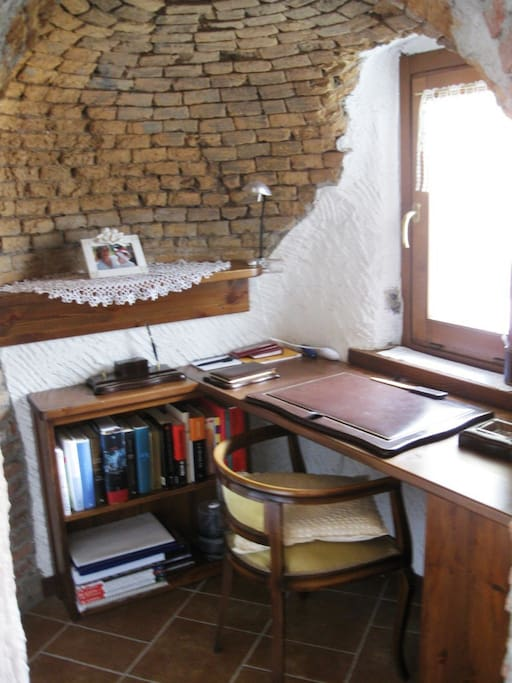 Ancient oven turned into a little office desk