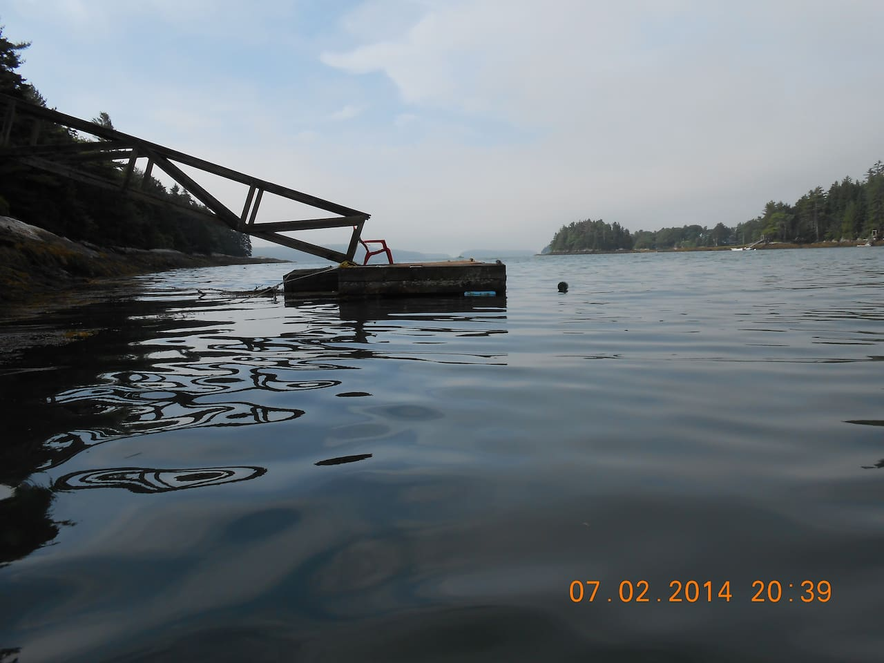 Our dock, with a view south, toward Malaga and Bear islands at the mouth of the New Meadows embayment