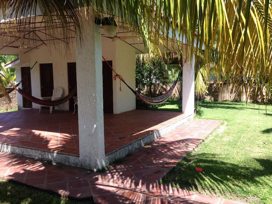 Partial view of the hamac rancho with bathroom and part of the garden