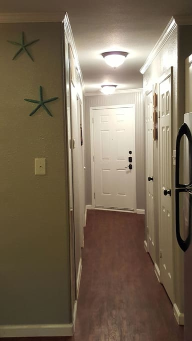 Hallway entrance to 420 sq ft condo, with hallway full length mirror ladies!