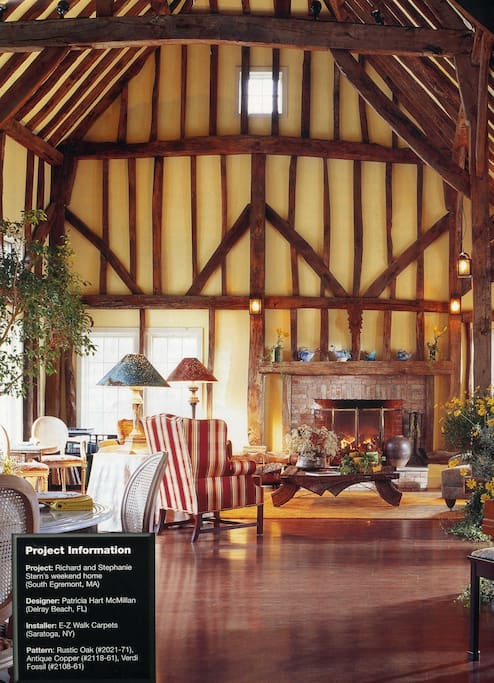 The Great Room, made with beams from a 15th century English barn, rises 3 stories high.