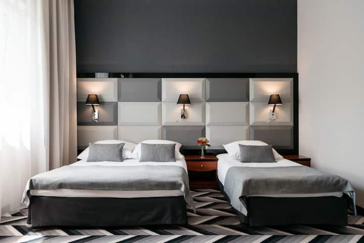 Trzyosobowy pokój w hotelu 4*