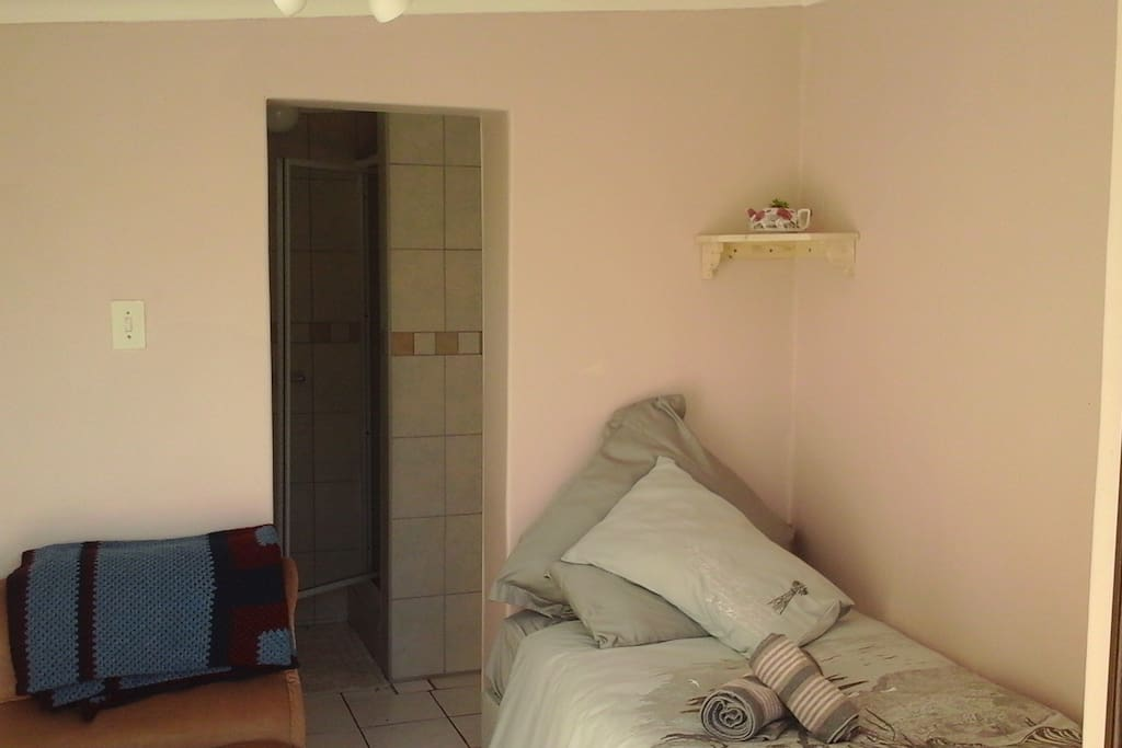 Comfy single bed plus shower,toilet,basin & cupboards
