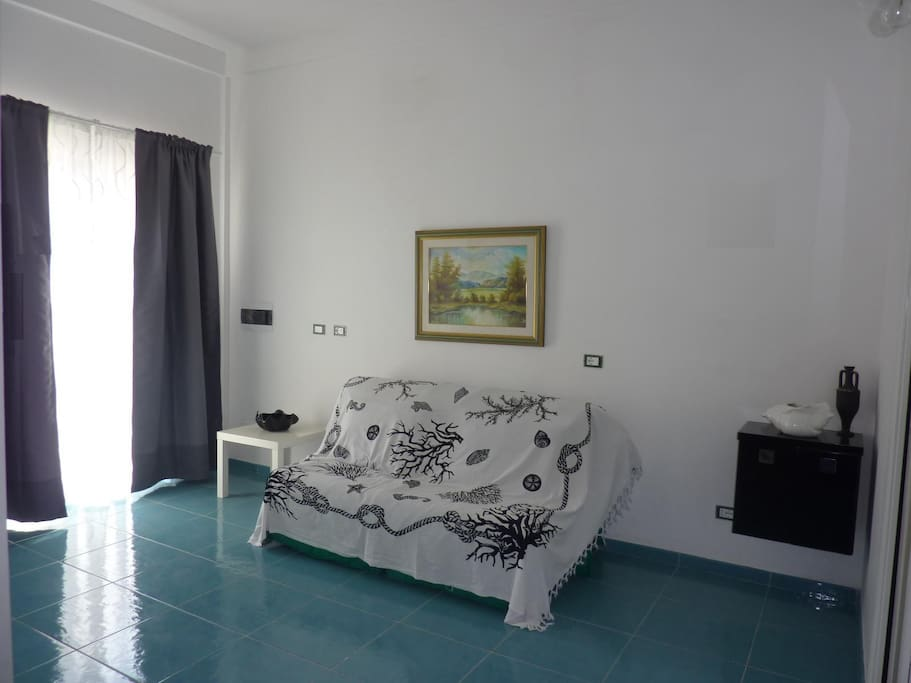 Open space with double bed
