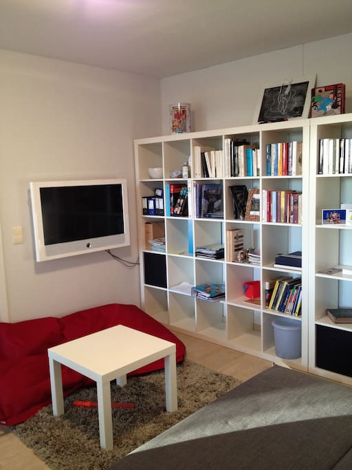 Living room with library and TV corner