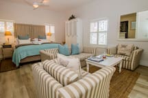 DELUXE GARDEN SELF-CATERING SUITE with own lounge area, opening to private patio garden