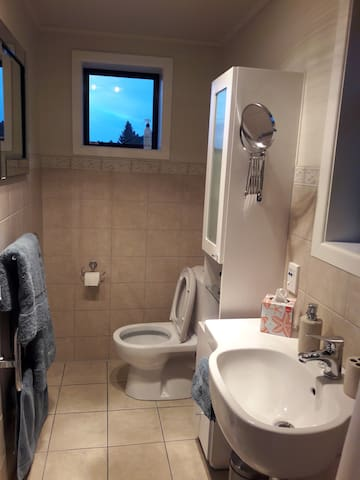 Personal bathroom/shower. Beautiful heated floor and towel racks for cold nights.