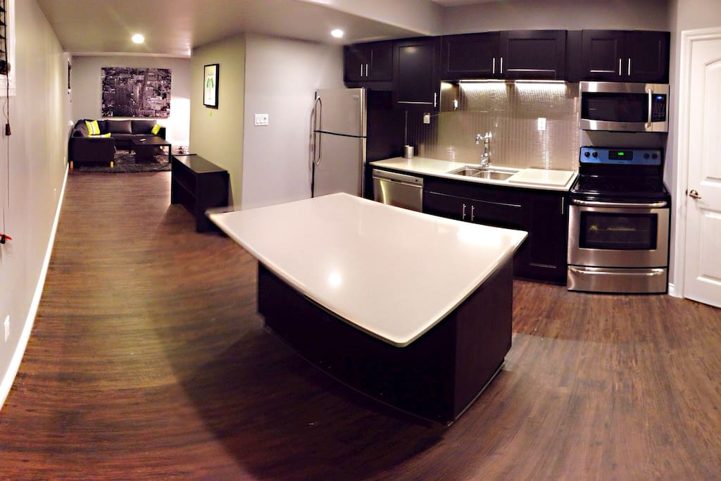 Featuring 9' ceilings, flush mount lighting and oversized windows this suite comes complete with all kitchen utensils, washer and dryer, private entrance and assigned parking.
