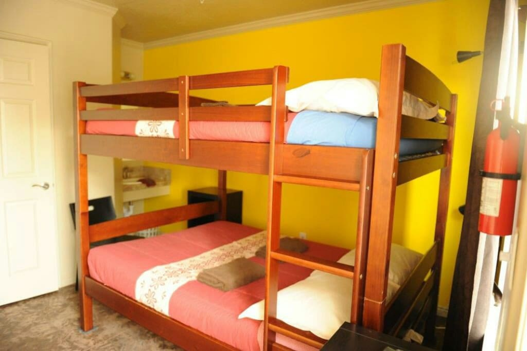 The family room has a bunk bed that has two full size beds (smaller than queen size)