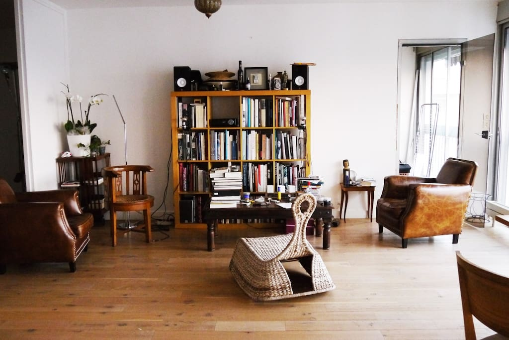 On one part of the Living room you have art books and a video projector. Enjoy watching your favorite movies!