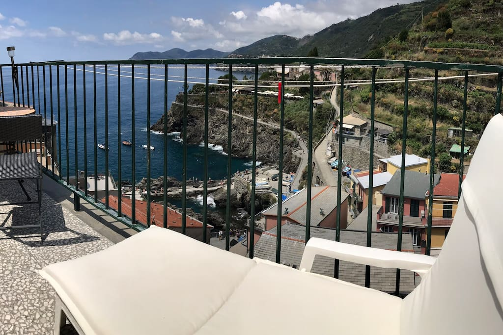 Panorama from the terrace. terrace furniture, comfortable deckchairs for sunbathing or relaxing to the sound of the sea. small table with two chairs suitable for breakfast, lunch and dinner on the sea.