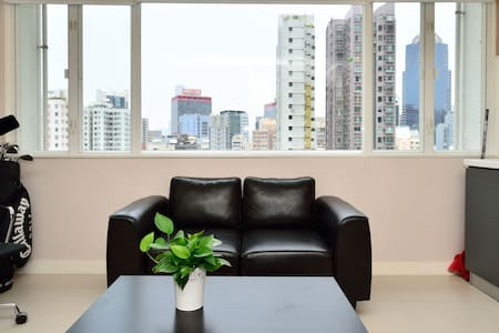 In the heart of Hong Kong.  Modernly furbished studio in old walk up building.  Close walking distance to all main attractions as Man Mo temple, antique market, financial district, SOHO, LKF, shopping streets.  Perfect base to explore HK shopping, partying and sightseeing.    Welcome to fabulous Hong Kong! Located in the heart of Hong Kong, my studio is a perfect base to experience this incredible energetic and exciting city. Right next to Man Mo temple one of the main attractions, only 5 minutes walking distance to the next MTR station and the famous SOHO restaurant area. On top of that only 10 minutes walking distance from LKF the party area, the main shopping streets and the financial center. The apartment is perfectly located. The front side is looking down on Hollywood (email hidden)ly street with an accumulation of the most famous and prestigious Hong Kong art galleries. Behind the house, there is a new art scene developing, with stylish coffee shops and smaller local art galleries, which invite for a casual Sunday afternoon walk. Unique for this neighborhood is that you are in the middle of a world metropolis and still its peace and quiet during night time. Located in one of the nowadays rare traditional walk up buildings, the modern but nevertheless cozy interior provides a great space to relax after a long day of shopping and sightseeing or a wild party night! The studio comes with a small and rather unused kitchen (in Hong Kong nobody really cooks as the variety of restaurants is simply too tempting) and a nice little bathroom. Wifi is included. I hope this description is meeting your expectations and look forward to host you soon!