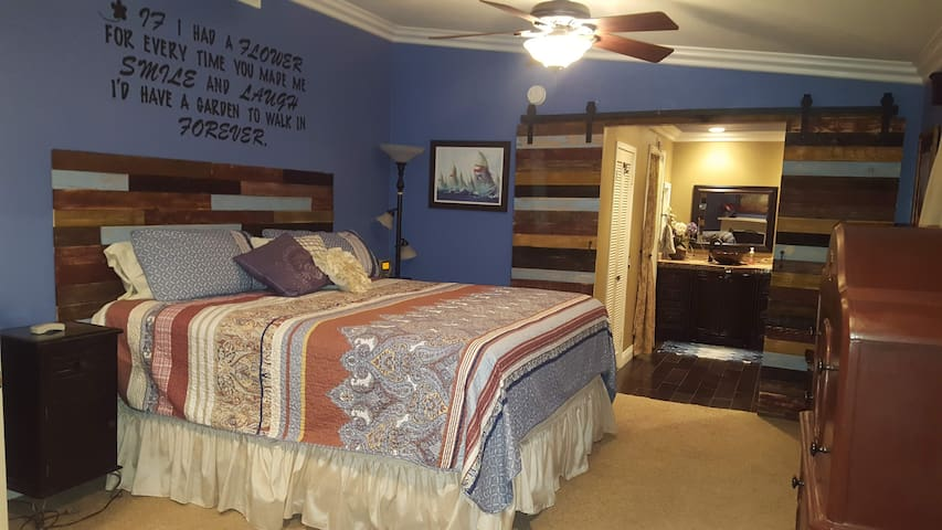 New bedding in master bedroom and privacy doors to bathroom