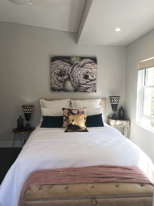 Queen bed in light filled space