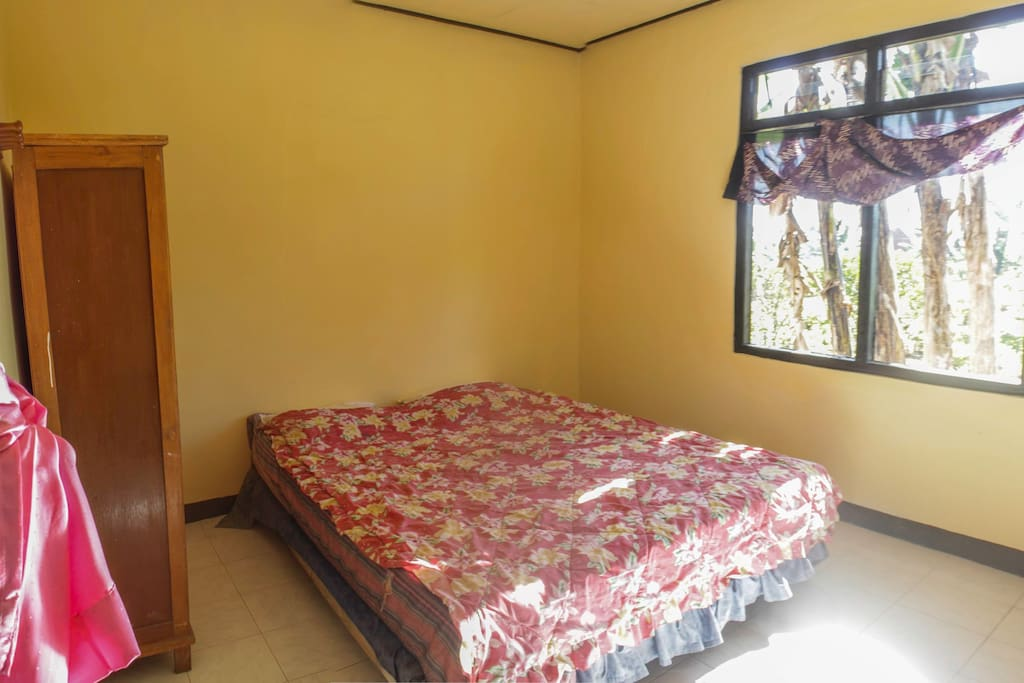 This is your room overlooking the next door flower plantation. Our guesthouse is located at the main road, however this room is in the back of the hotel so you won't have any problems with noise