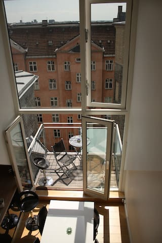 View from the extra floor down on the double-floor windows and the balcony.
