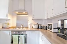 Kitchen: gas hob, electric oven, microwave and coffee machine