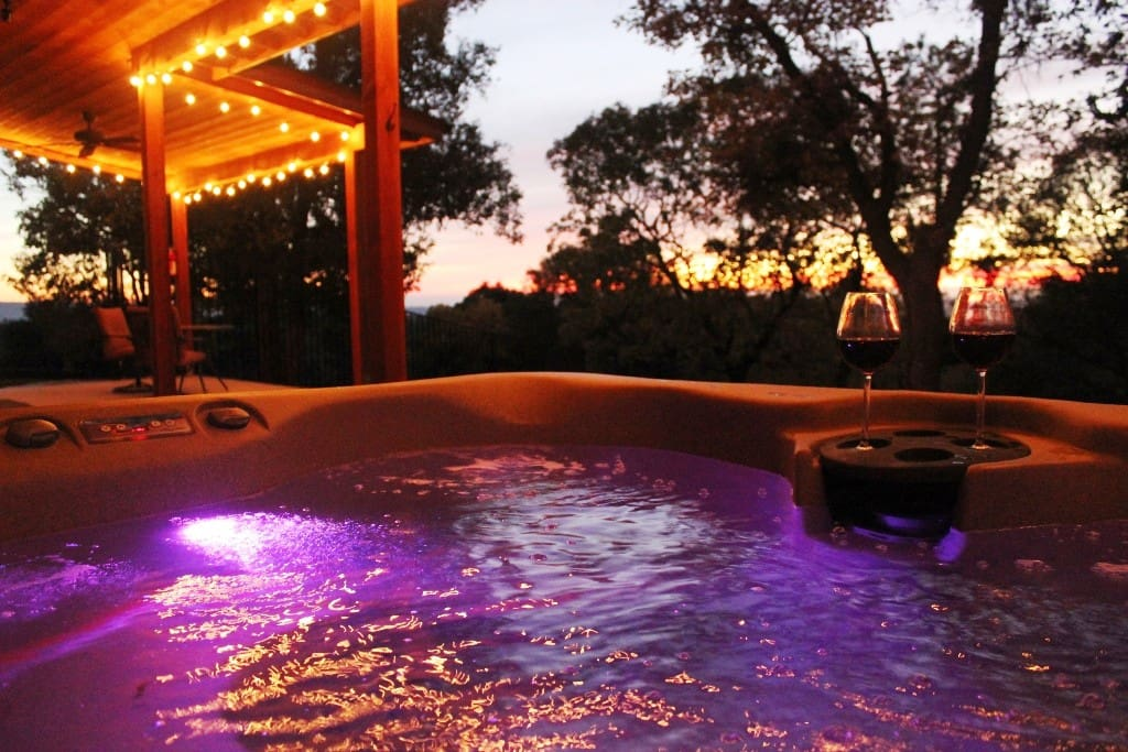 Stunning sunset views to enjoy from covered hilltop patios with outdoor hot tub