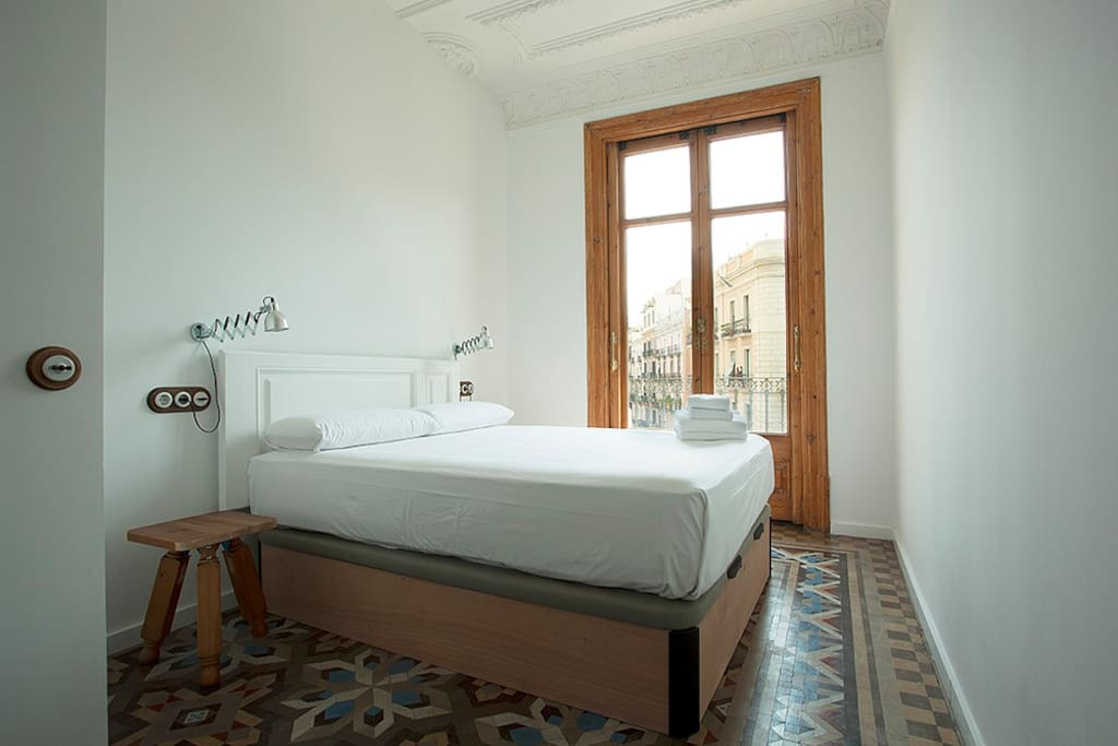 Room 2 with a luxury queen size bed, a balcony and Catalan Modernism features.