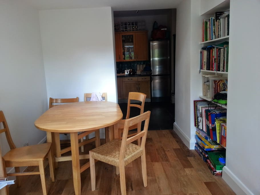 New dining room with wooden floor and French windows leading to back garden