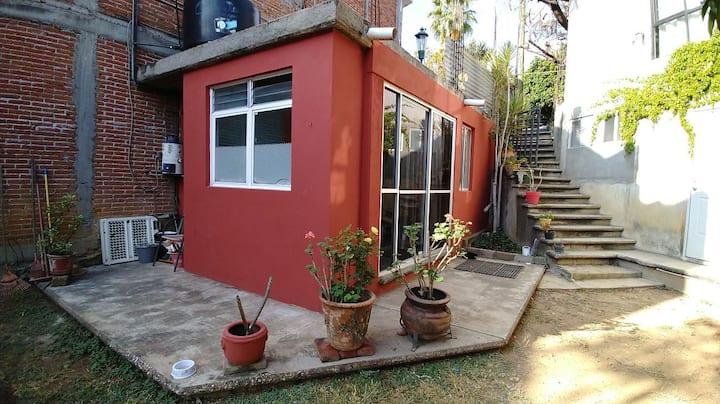 Pequeña suite con jardín