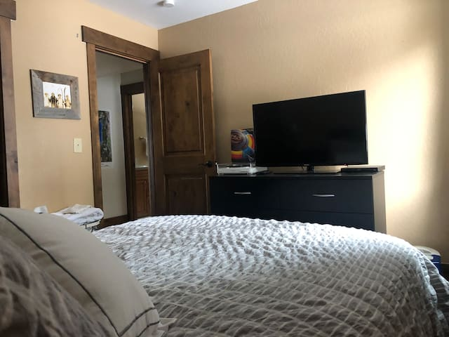 Downstairs bedroom with queen bed and TV with DVD player. (No cable access).
