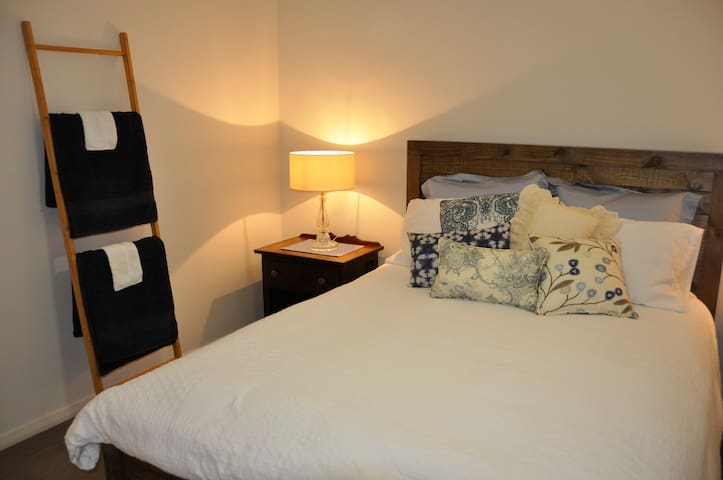 Bedroom 3 featuring queen bed, electric blanket, ceiling fan, built in wardrobe with robes for guests use