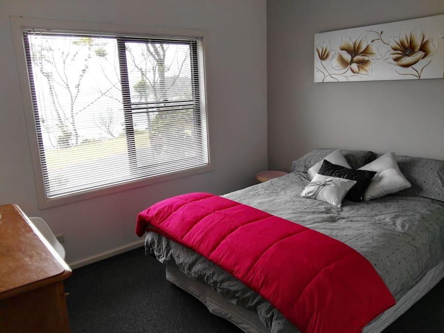 Bedroom 1 upstairs; queen bed