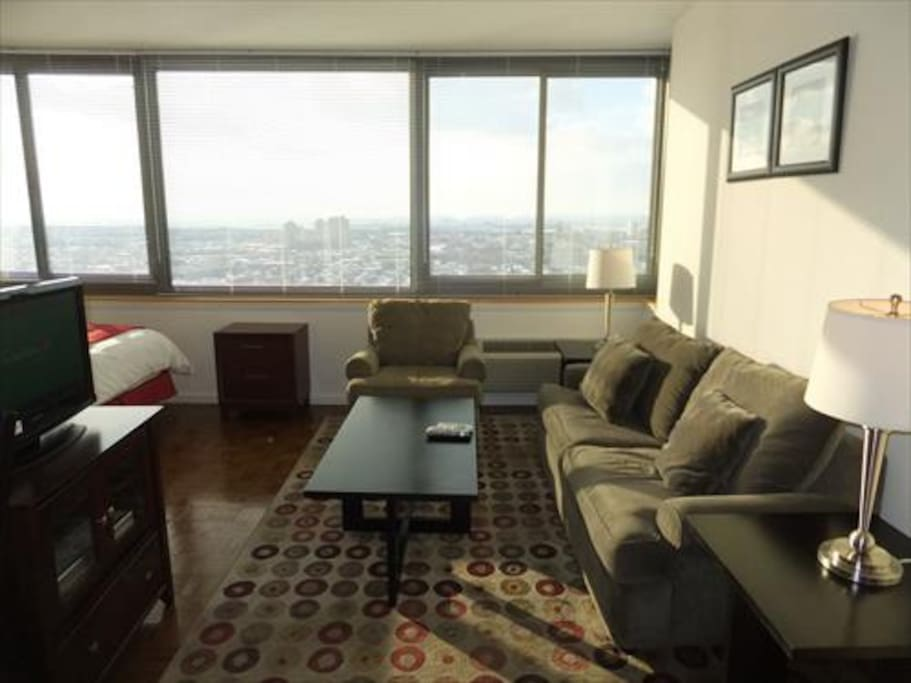 Spacious living area with sofa bed, LCD flat panel TV with cable channels, DVD player and stereo
