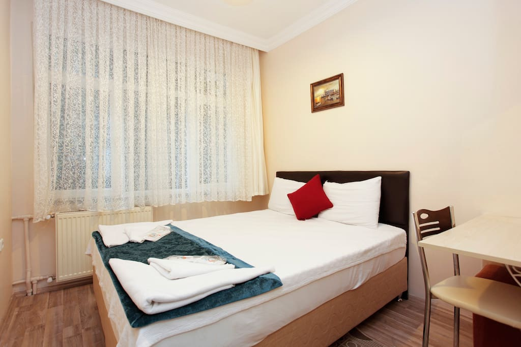 One of the bedroom with a big comfortable double bed